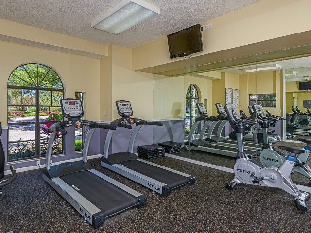 Fitness center treadmills and bikes at Village Place