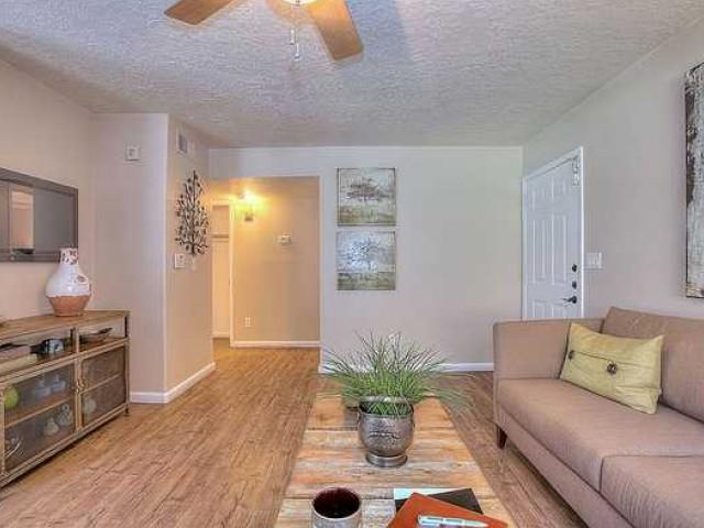 LIving room with hardwood flooring in 1 bedroom apartment at Vizcaya | Santa Fe apartments