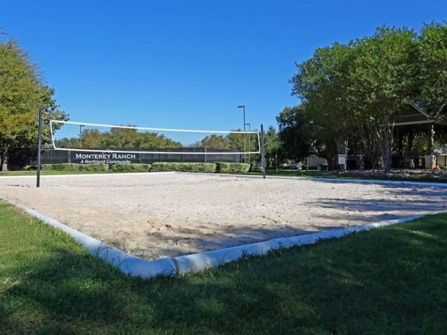 Sand volleyball court | Monterey Ranch amenities | Austin apartment community