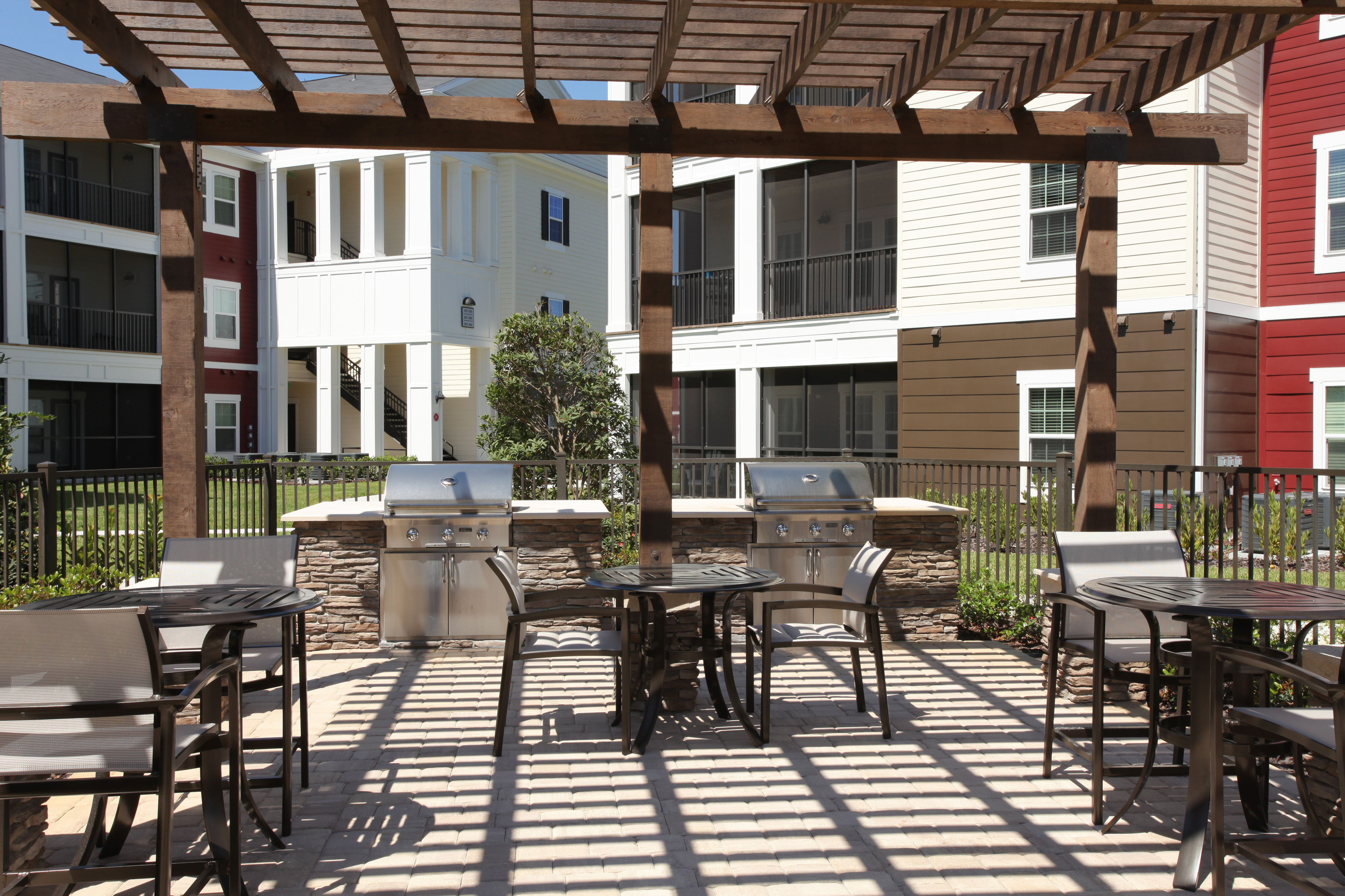 Poolside picnic tables and gas grills | resident amenities at The Village at Terra Bella apartments