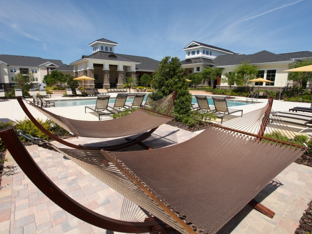 Poolside hammocks | Village at Terra Bella
