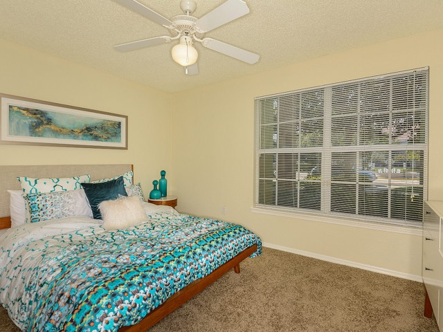 2 bedroom apartment master bedroom with carpet and ceiling fan | Royal St George