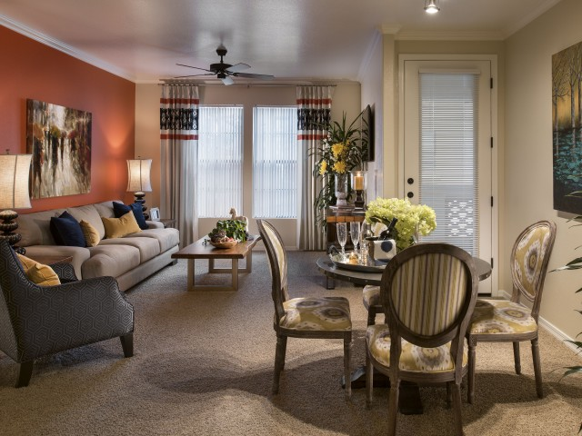 Dining room and living room with carpet and ceiling fan | 1 bedroom apartment in Villas at San Dorado