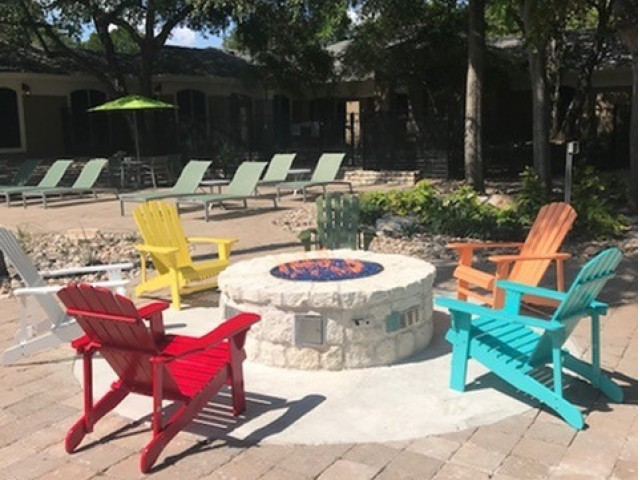 fire pit with colorful adirondack chairs