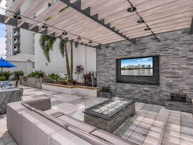 Rooftop patio with outdoor fireplace | community gathering areas | The Paramount | downtown Orlando apartments