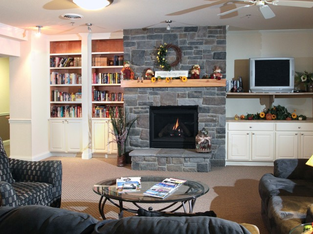 Image of Separate Family Room with Fireplace & Library for Smaller Family Gatherings for Liberty Square