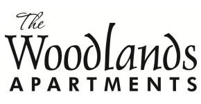 The Woodlands Apartments  Logo