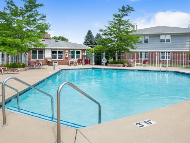 Image of Sparkling Outdoor Pool with Sundeck for Foxcroft Apartments