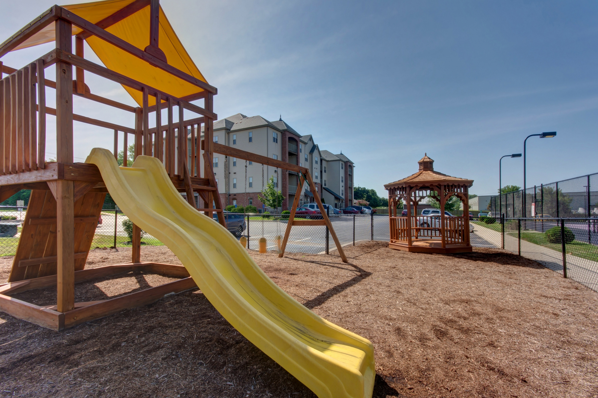 Coryell Courts Apartments amenity kids playground with slide and swing