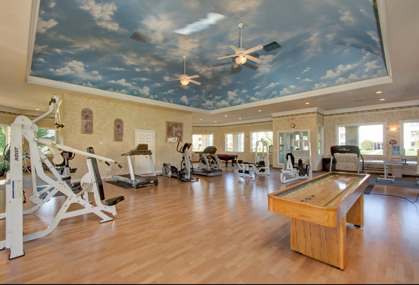 fitness facility with shuffle board and fitness equipment