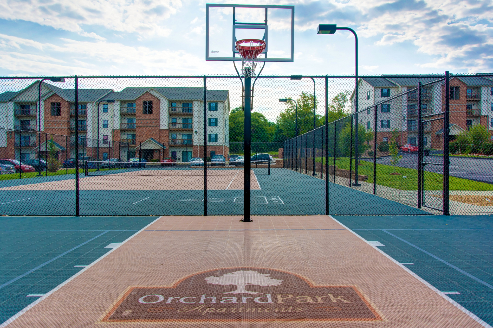 Orchard Park Apartments amenity outdoor basketball court and tennis court