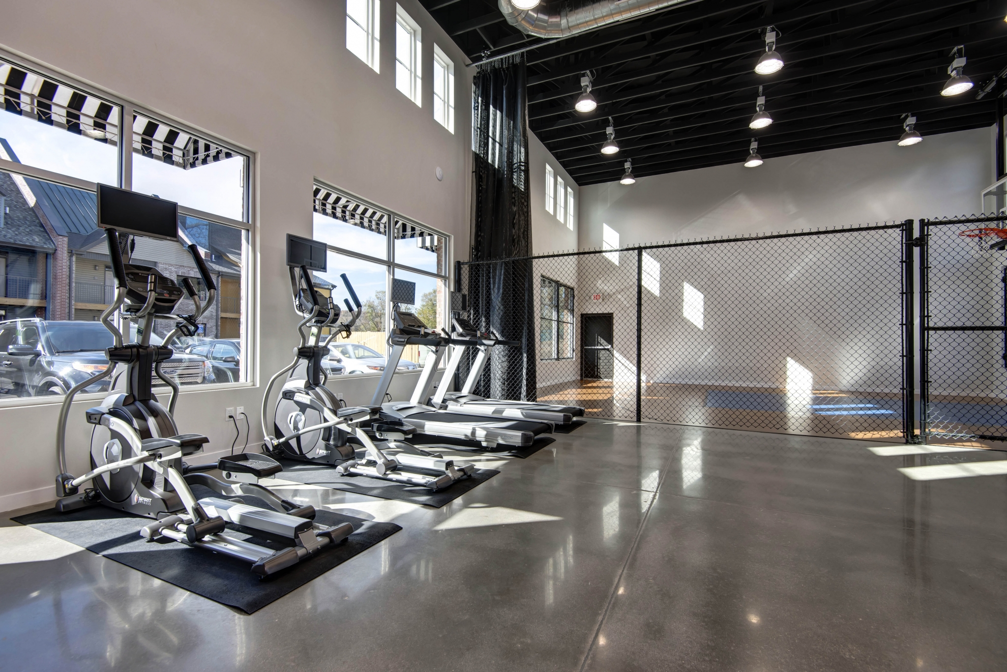 Township 28 Apartments amenity fitness center and indoor basketball court