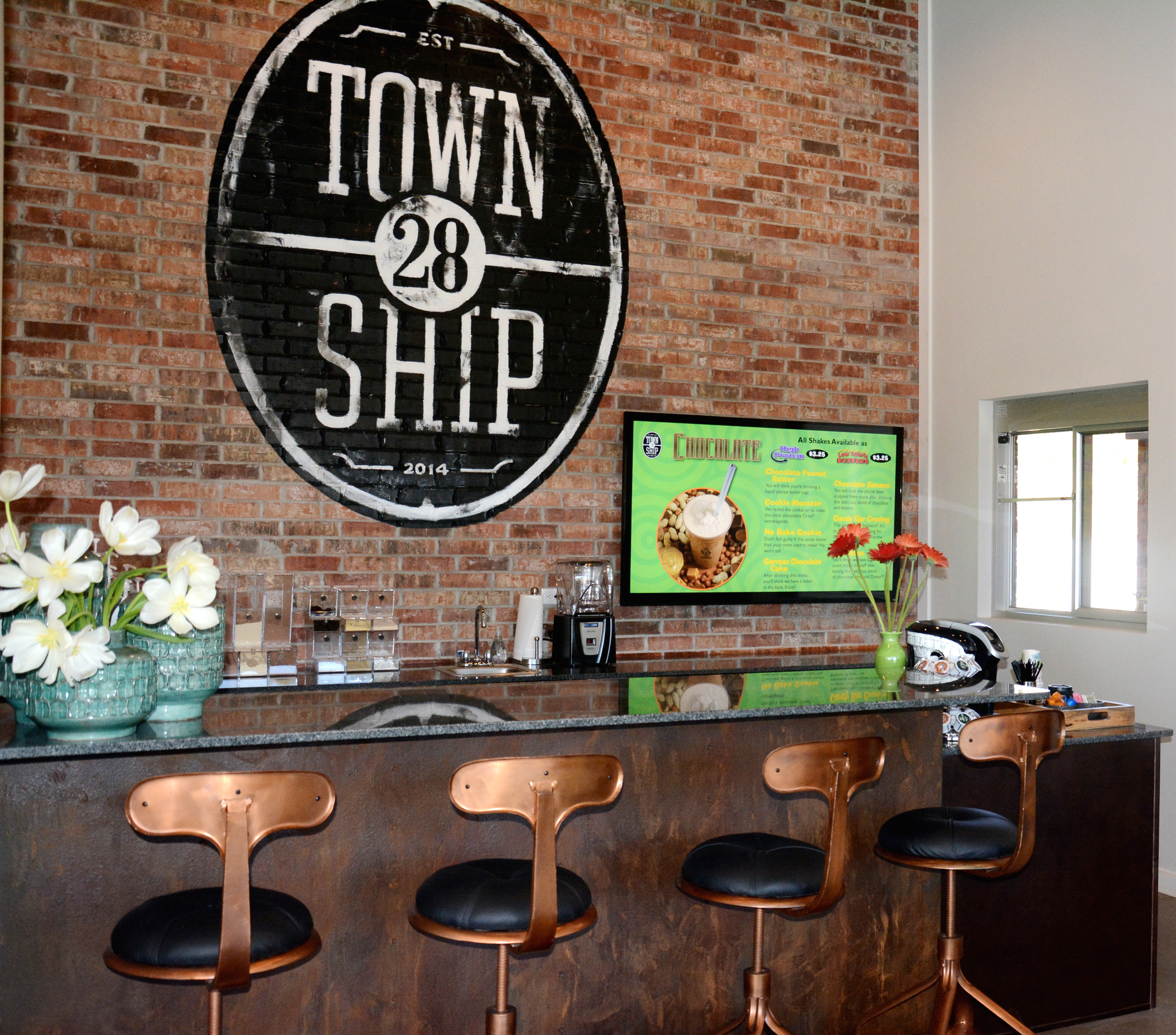 Township 28 Apartments - amenity clubhouse with smoothie bar and brick accent wall