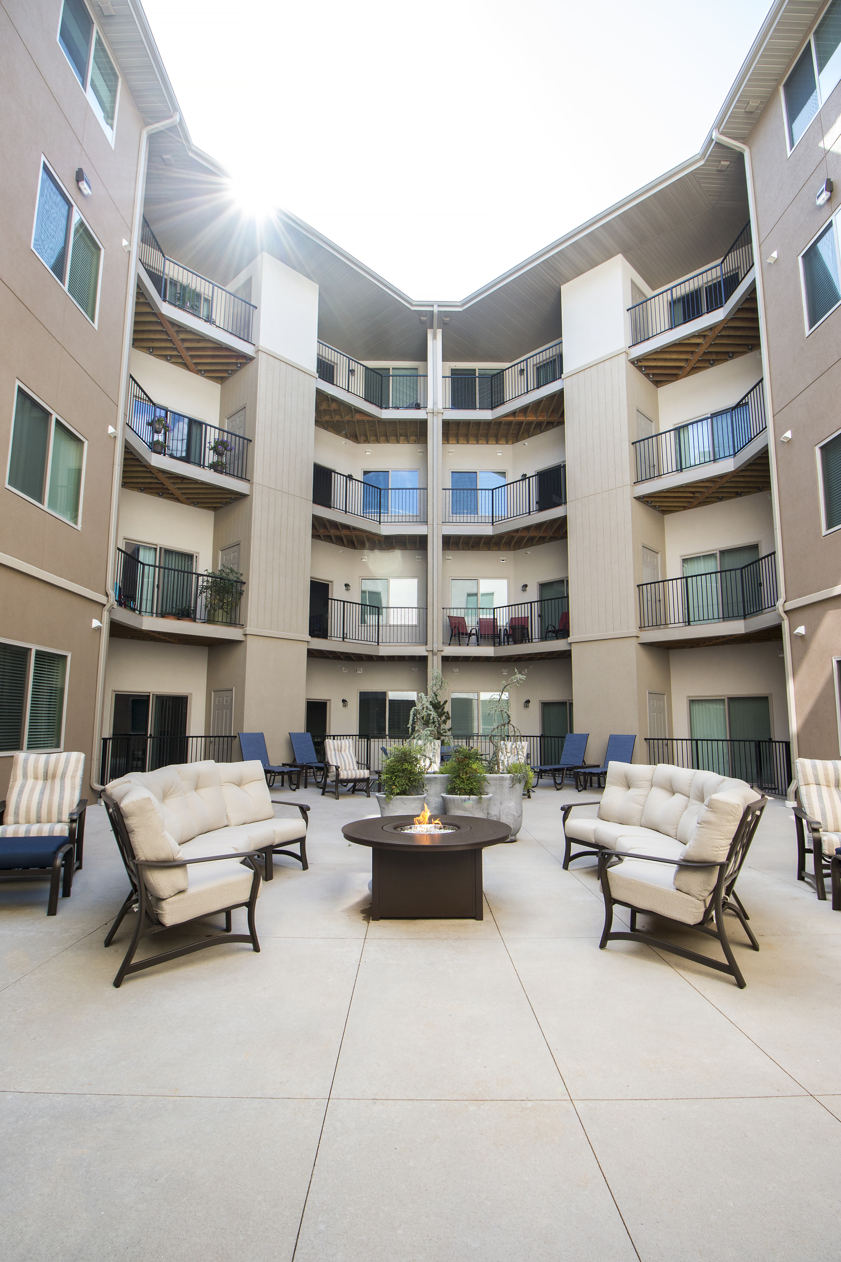 Coryell Commons 55+ courtyard with seating and fire pit