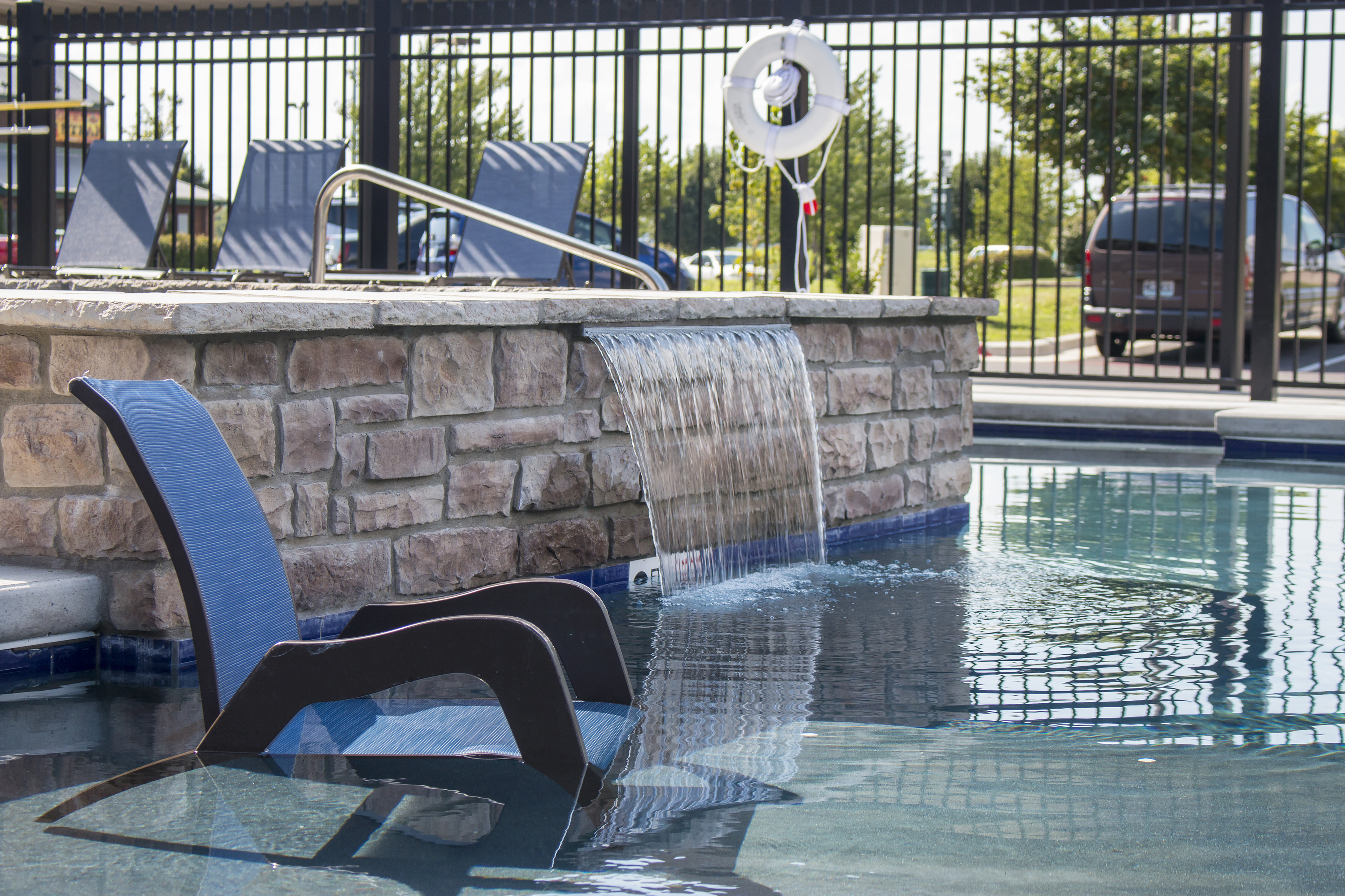 Coryell Commons 55+ hot tub with waterfall and in-water seating