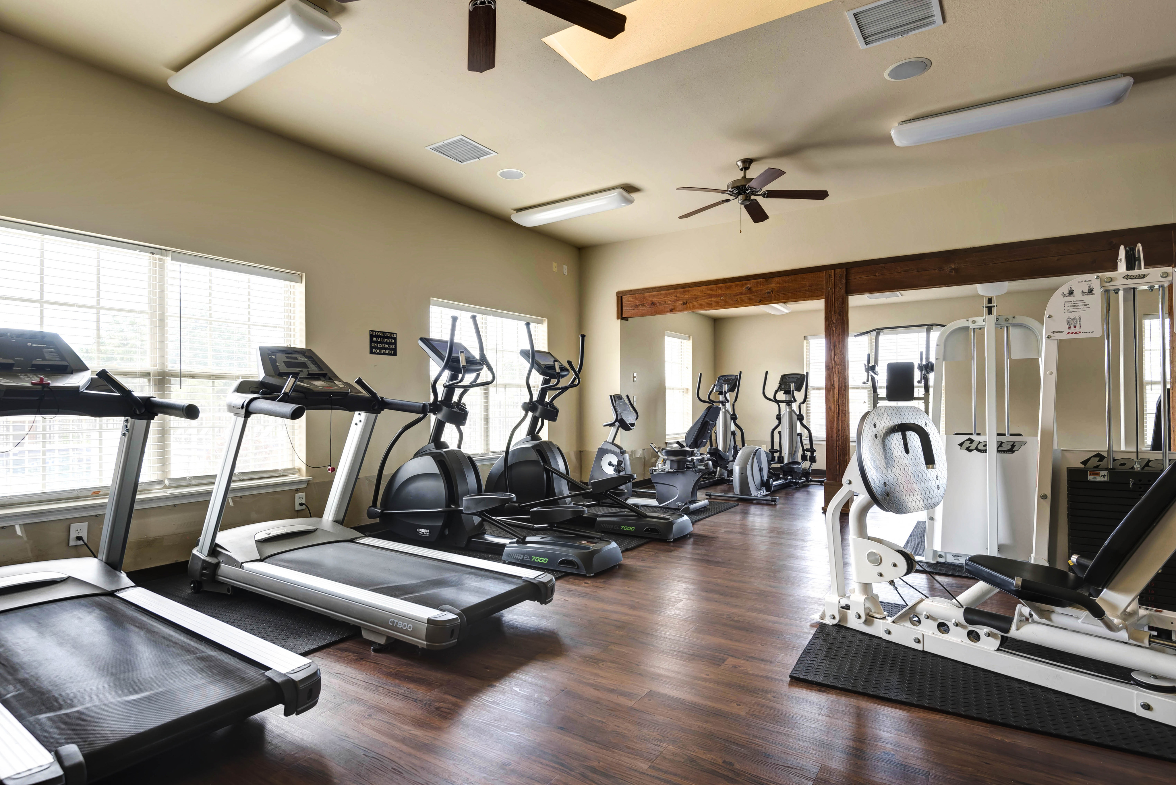 Coryell Courts fitness center with cardio equipment