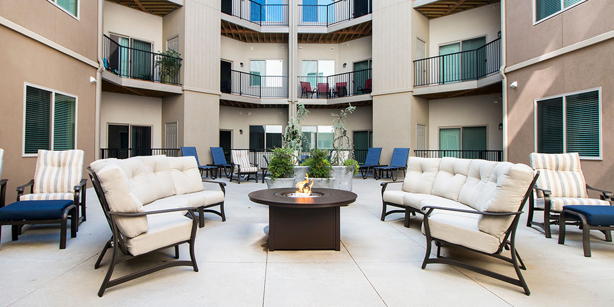 tlc properties luxury apartment with firepit in patio