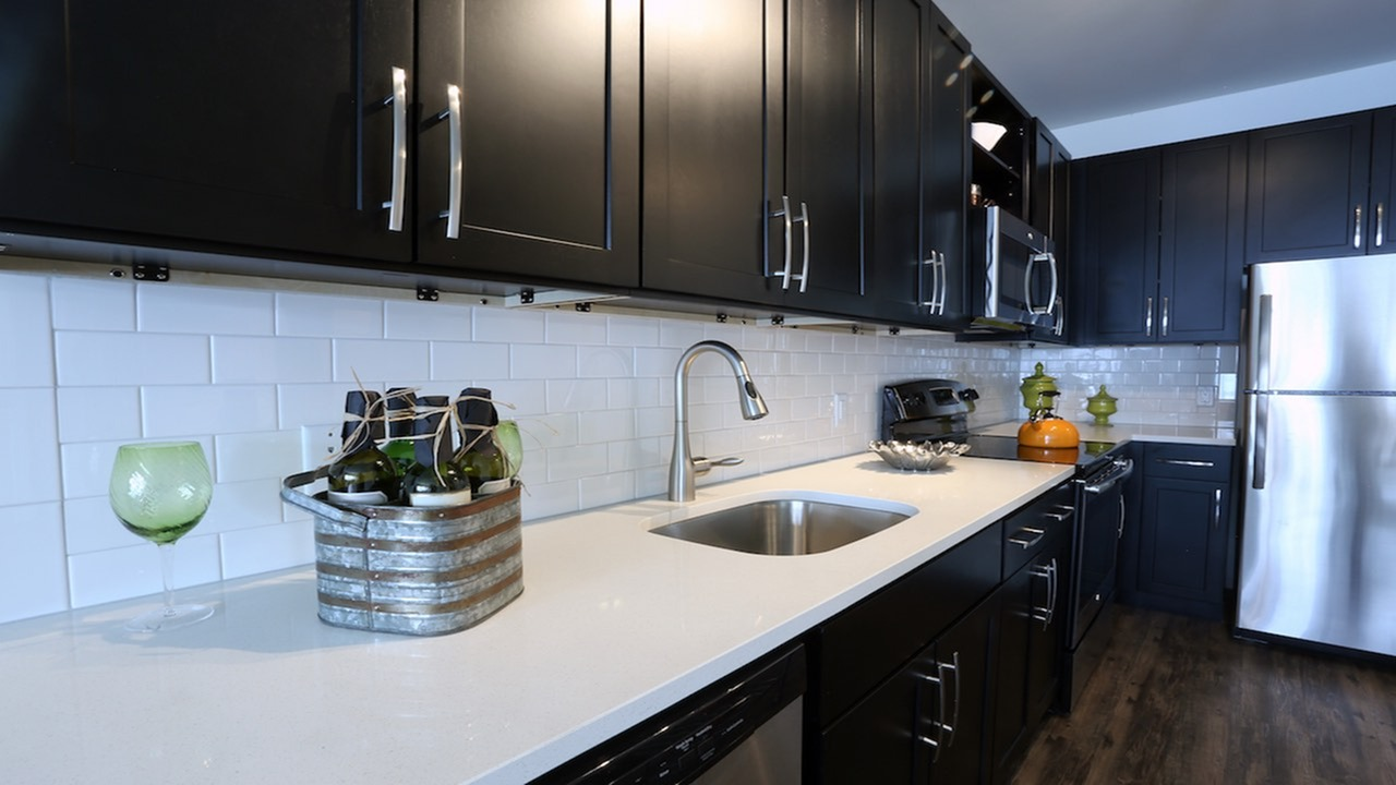 Sleek Subway Tile Backsplash and Quartz Counter in Modern Kitchen