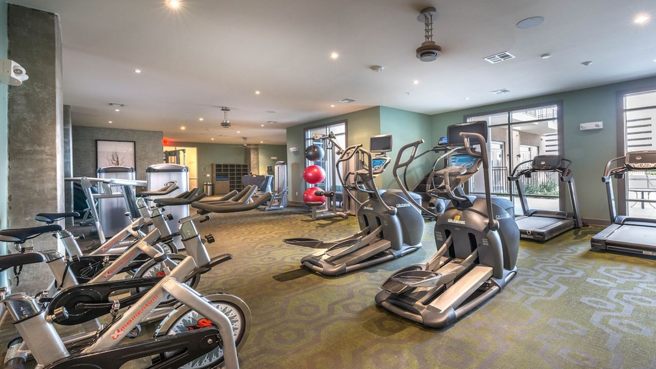 Fully Equipped Fitness Center with Spin Bikes, Elliptical, and Treadmills