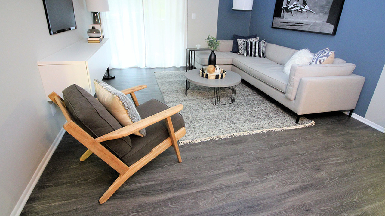 Living Room with Couch and Accent Chair featuring Faux Wood Style Flooring