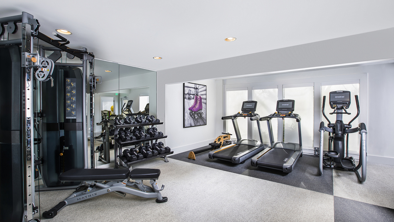State-of-the-Art Fitness Center with Free Weights, Weight Machines, and Cardio Equipment