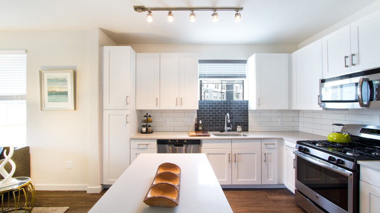 Modern Kitchen with Quartz Counters, Subway Tile and Stainless Appliances