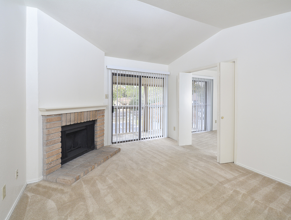 Living Area | Fireplace | Sliding Door to Balcony | One Bedroom at Stoneleigh Apts