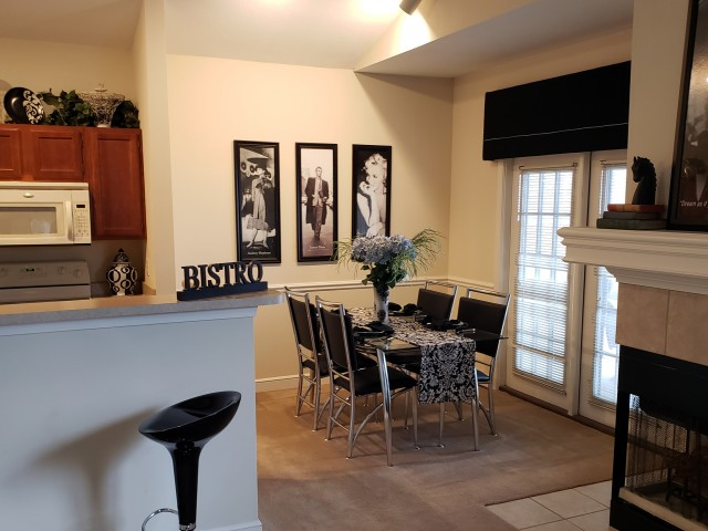 Image of Custom Crown Molding and Stylish Chair Rails Available for The Woods of Cherry Creek Apartment Homes