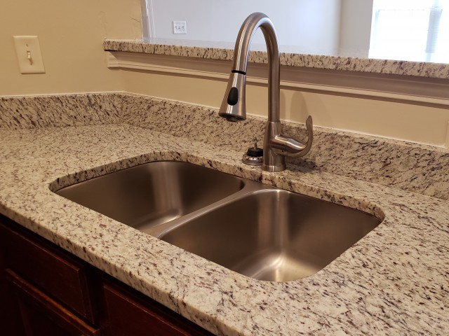 Image of Granite upgrade in select homes for The Woods of Cherry Creek Apartment Homes