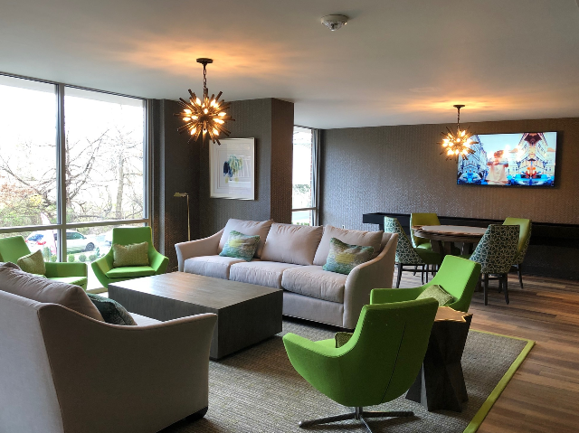 Resident Lounge with TV and Gathering Tables