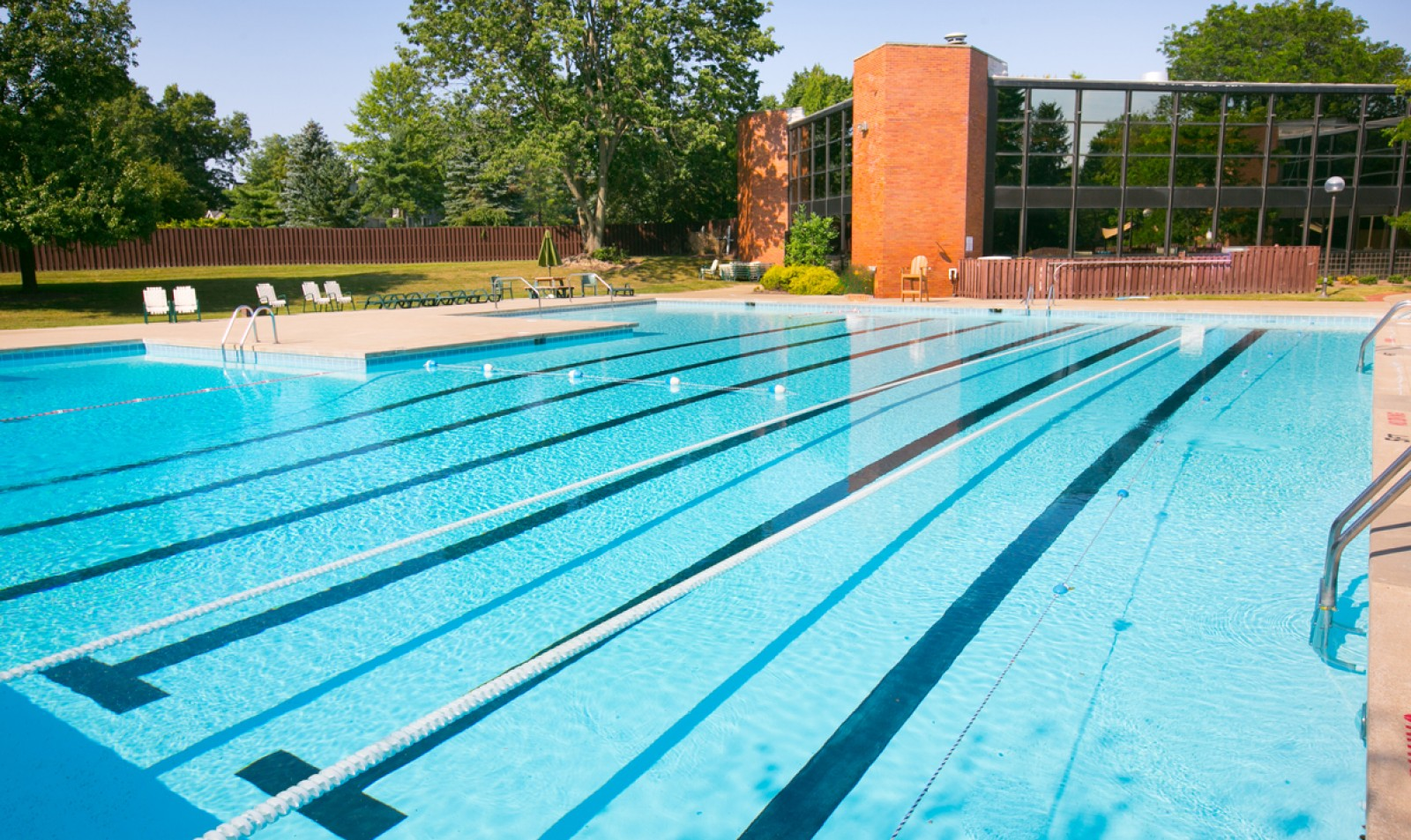 Relax at one of our two outdoor swimming pools with poolside WiFi at Williamsburg Townhomes Rental Homes in Sagamore Hills, OH