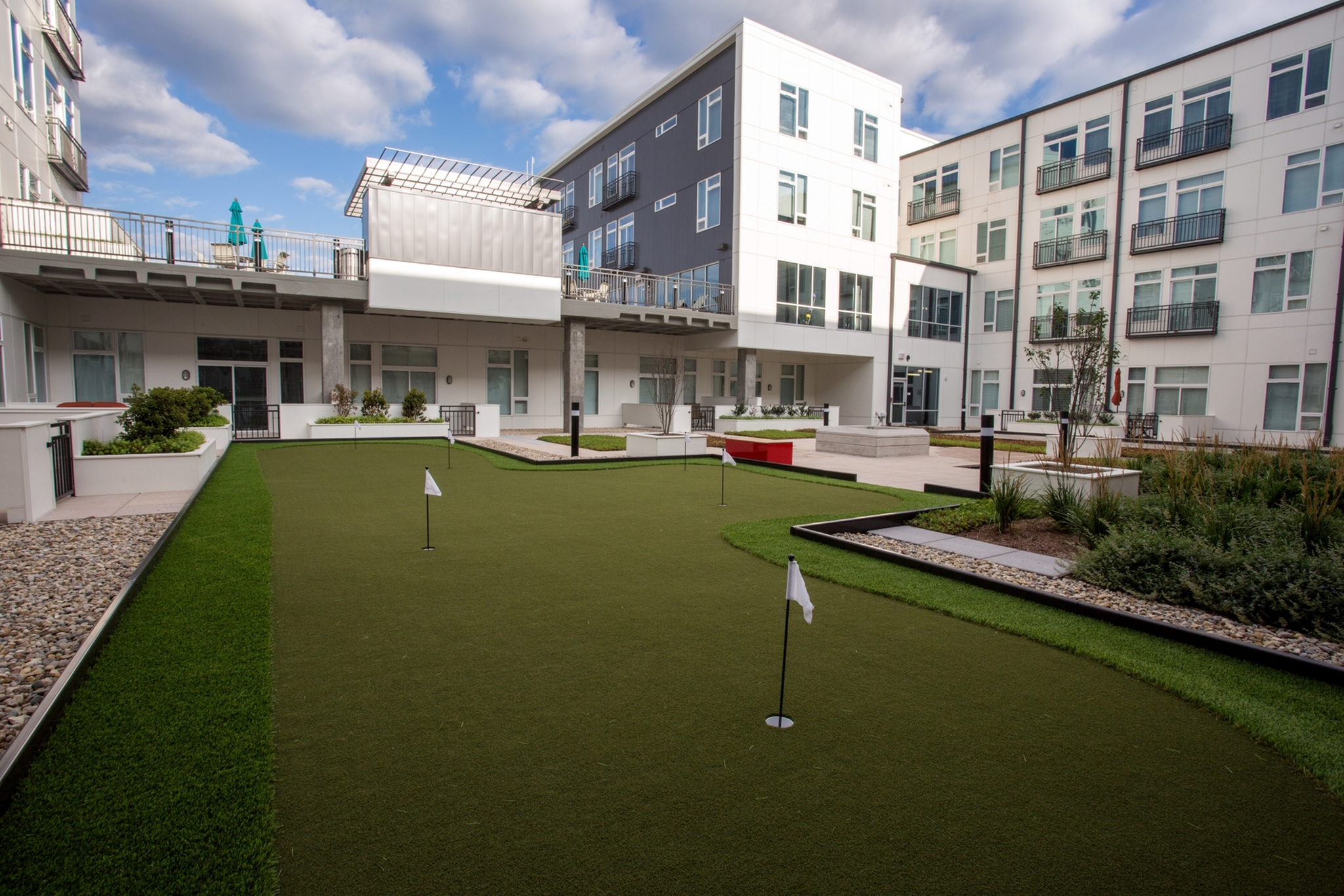 Image of Active Courtyard featuring a Bocce Court and Putting Green for Artistry