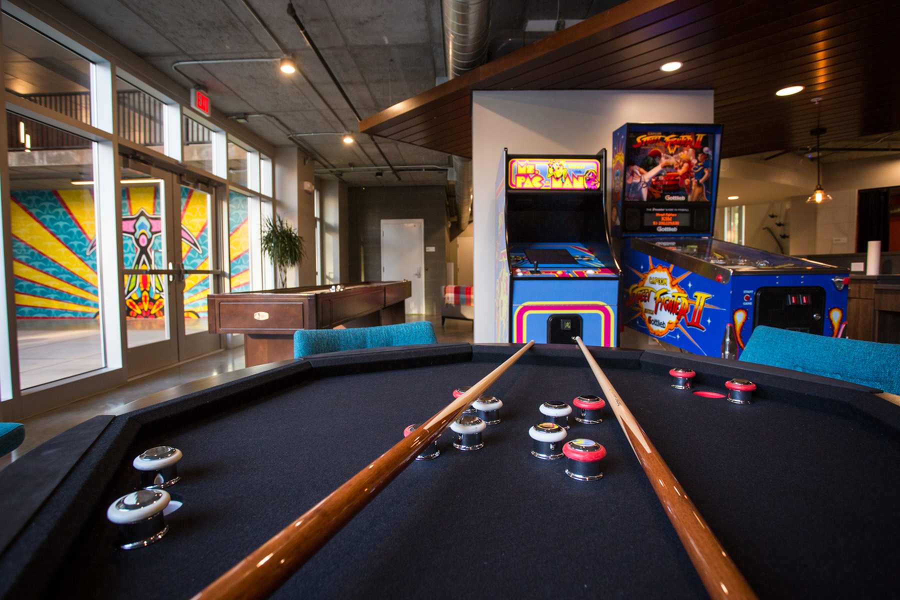 Image of Entertainment Bar with Shuffle Board Fooz Ball and Vintage Arcade Games for LIFT