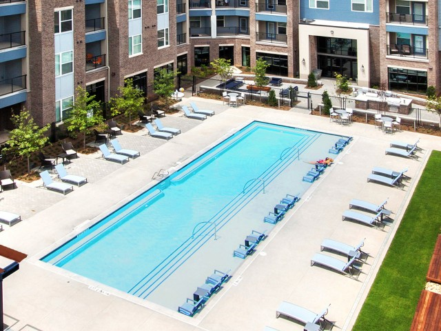 Image of Pool w/Sun Shelf and Bubblers for 1760 Apartment Homes