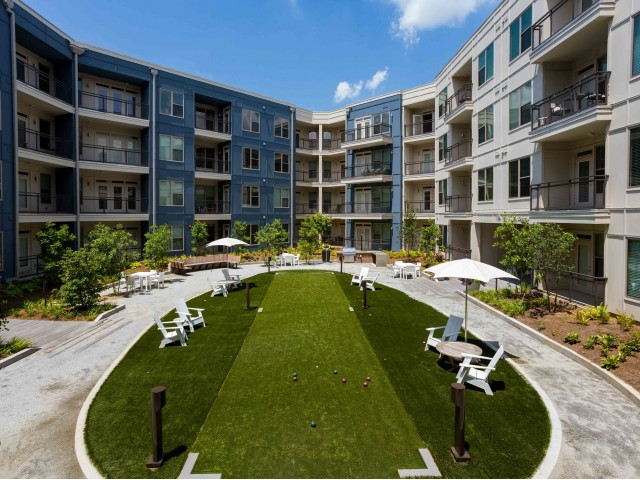 Image of Dual-Faced Gas Fireplace, TV Gallery and Bocce Area in the Courtyard for Millworks