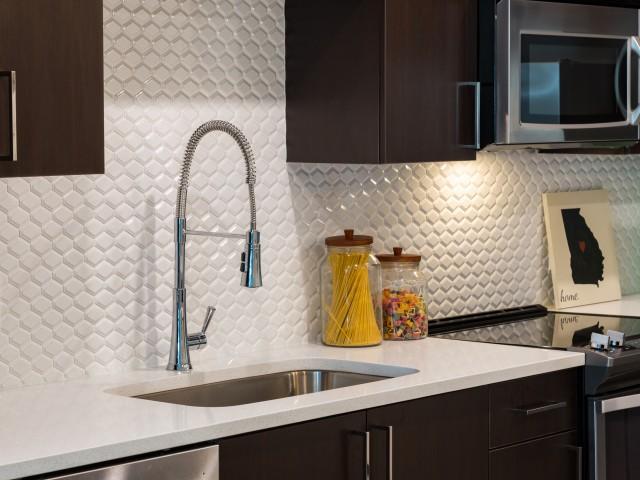 Image of Charming Subway Tile Backsplash in Kitchen for Millworks