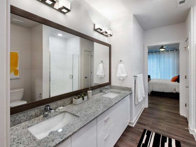 furnished bathroom with open door to bedroom