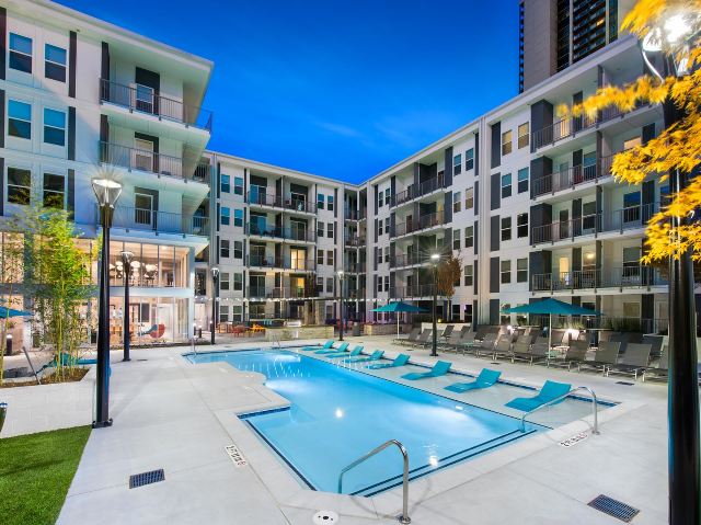 pool and apartment building at nighttime