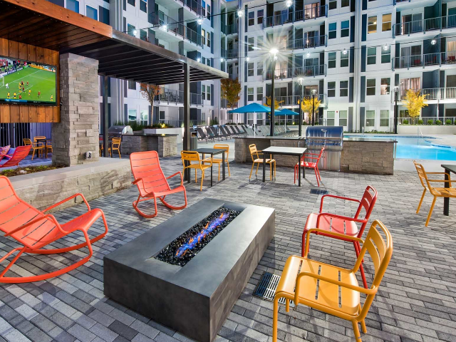 outdoor area with seating, kitchen and firepit