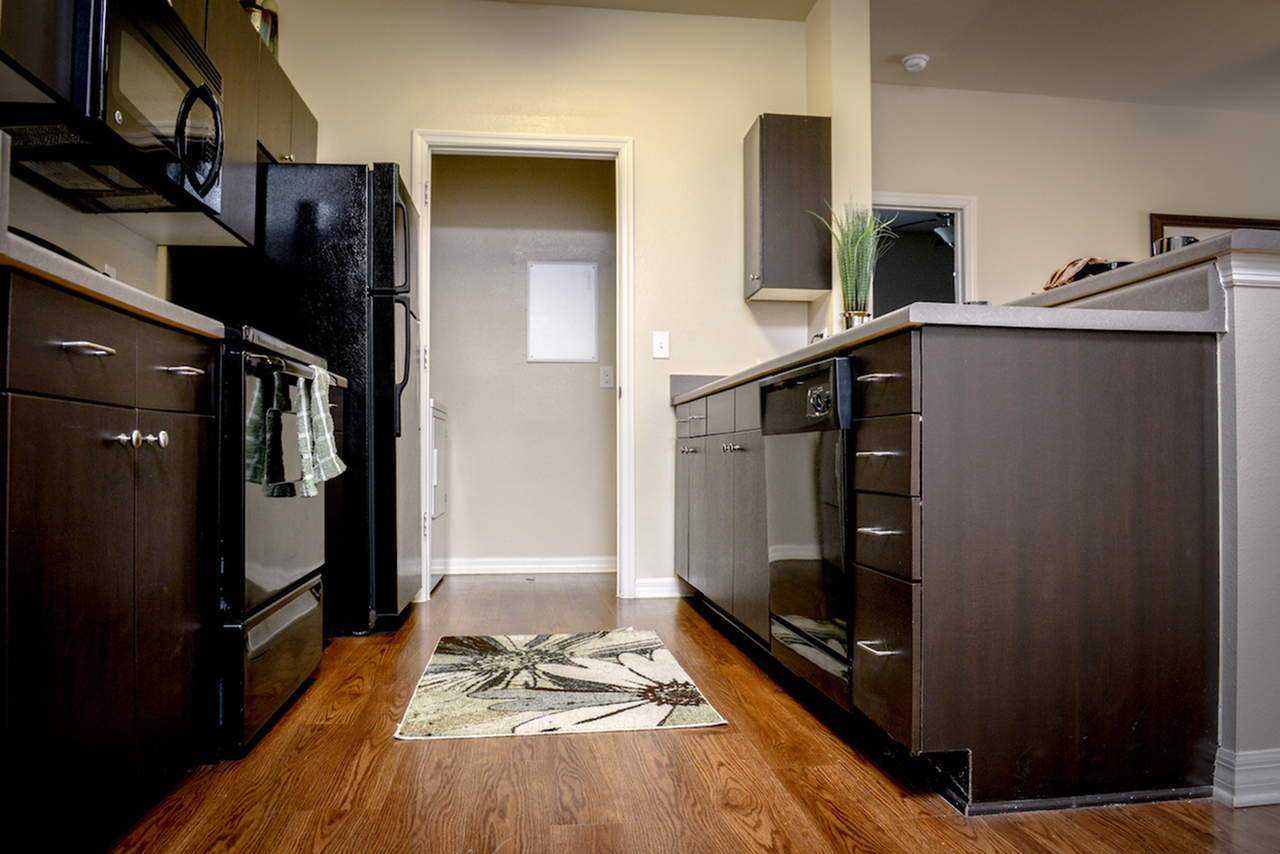 Image of Dark Wood Cabinetry for Independence Place West Fayetteville